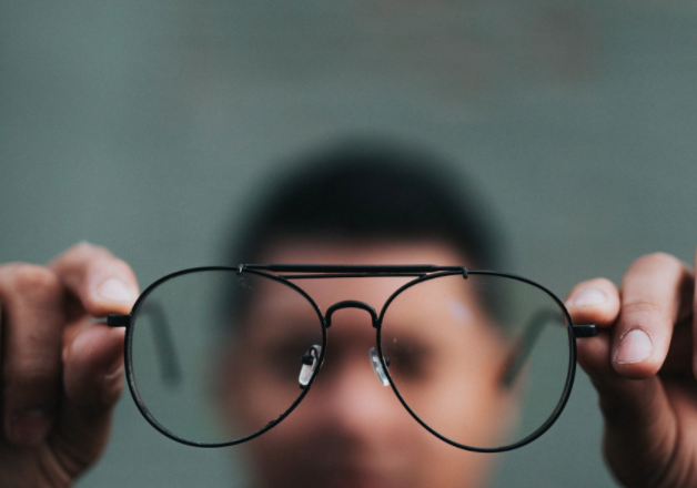 your vision for your life man holding spectacles
